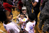 (PG8328) Sgt. 1st class Moses Santana spends time with his children (from left) Nyah, 8, Moses, 3,...