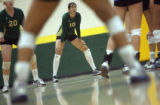 (at centet)  Mountain Vista HS Ariel Turner (cq) waits for Highlands Ranch HS to serve the ball at...