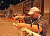 Curt Jennings (cq) repairs some taps, Friday morning, October 10, 2008, at the Colorado Convention...