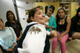 0221 Earth science teacher Pattyanne Corsentino plays with a pet tarantella Fifi with her students...