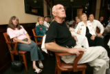 0045 Bo Cottrell, of Aurora, joins the Veterans for McCain who hosted a gathering to watch the...