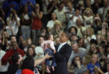 Senator Obama speaks to a crowd at Mountain Ridge High School in Westminster on September 29,...