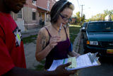 Terry Baccus, (cq) a political organizer who works with ACORN, talks to Jessa Lubken, 23, (cq) as...
