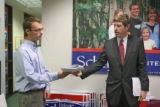 Josh Shields (cq), left, Schaffer campaign staff member, takes information from Allen Stayman,...