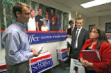 Josh Shields (cq), left to right,, Schaffer campaign staff member, talks to Allen Stayman, veteran...