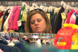 Kelly Anderson (cq) shops for her two young children at Children's Orchard , a thrift store in...