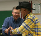 Bob Schaffer, Republican candidate for United States Senate, greets resident, Terry DeWitt (cq) of...