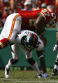 JOE0820 Denver Broncos Champ Bailey (24) upends Kansas City Chiefs Larry Johnson causing a fumble...
