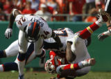 JOE0827  Denver Broncos Champ Bailey (24) upends Kansas City Chiefs Larry Johnson causing a fumble...
