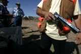 0856 Johnny Quintana prepares his 454 Casull hand gun as he joins in at the first annual Elbert...