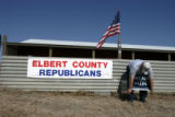 0494 Scott Wills, Elebrt County Republican chair, prepares the site for the first annual Elbert...
