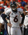 JOE0914 Denver Broncos quarterback Jay Cutler paces the sideline after his pass for Broncos...