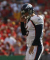 JOE1226 Denver Broncos Jay Cutler walks off the field after failing to convert a third down...