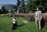 DJ Edwards (cq), left, takes a photo of her husband Bill Edwards (cq) in Civic Center Park,...