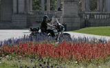 A Denver Police officer rides through Civic Center Park, Wednesday afternoon, October 1, 2008,...