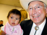U.S. Sen. Ken Salazar and his 9-month-old granddaughter, Mireya. (Photo by Lynn Bartels)