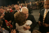 John McCain hugs supporter Celia Lopez after a town hall meeting for women in the Grand Ballroom...