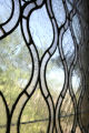 Detail of one of the leaded-glass windows in the Taylor Mansion.  The house will be on the Dora...
