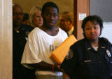 Suspect Willie Clark walks into the courtroom to be advised of the charges against him for the...