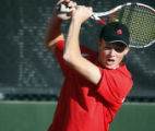 CODZ107 - Rocky Mountain's Casey MacMaster returns a shot in his No. 1 singles match against...