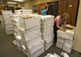 Jane Frick (cq), left, and Stephanie Stroh (cq), temp workers, sort 400 ballots, out of these...