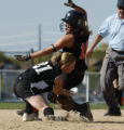 Erie's Kaylynn Harmon is tagged out on a steal to 2nd by Limon's Ashton Taylor on 2nd in the 3A...