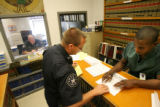 MJM151 Sheriff Deputy William Mitko (cq), center, gives instructions to Denver County Jail inmate,...