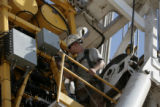Jordan Phelps (cq) keeps his eye on the injector section of this Coil Tubing Drill Rig, as they...