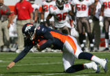 0181 Denver Broncos (7) Jay Cutler dives short of the first down marker with his knee landing on...