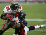 0295 Denver Broncos (58) Nate Webster, right, tries to wrap up Tampa Bay Buccaneers (28) Warren...