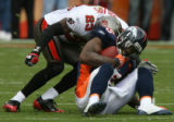 0239 Denver Broncos (15) Brandon Marshall is hit by Tampa Bay Buccaneers (23) Jermaine Phillips...
