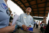 Hank Eng chats with  Janet Slate at the Civic Green Park after a 'Women for Obama' rally in...