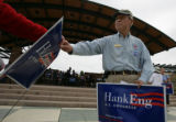 Hank Eng hands out yard signs at the Civic Green Park  after a 'Women for Obama' Littleton, Colo....