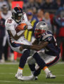 (CS461) Brandon Marshall is tackled by Jerod Mayo in the first quarter of the Denver Broncos...