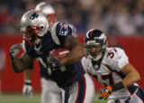 (CS033) Sammy Morris runs in the second quarter of the Denver Broncos against the New England...