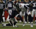 JPM818 Denver Broncos  wide receiver Brandon Marshall (15) pulls in a pass against New England...