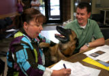 (PG16044) Denise and Brian sign final adoption papers for Neeko at Aurora Animal Shelter on...