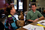 (PG16021) Denise and Brian sign final adoption papers for Neeko at Aurora Animal Shelter on...