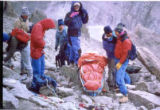 Photo of Jim Davidson, center, during a rescue on Longs Peak in 1991. Jim Davidson was descending...
