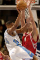 (Denver, CO., January 9, 2004) Andre Miller tries to pass the ball while Yao Ming defends the...