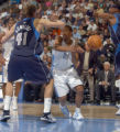 Denver, Colo., photo taken December 26,2004- Nuggets guard, Andre Miller, gets the ball knocked...