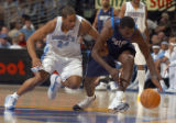 Denver, Colo., photo taken December 26,2004- Nuggets guard, Andre Miller, knocks the ball loose...