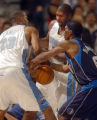 Denver, Colo., photo taken December 26,2004- Nuggets players, Marcus Camby (left) and Nene...