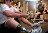 Phil Bauer, left, and Captain David Rozelle, both members of 3rd Armored Cavalry, work out at Fort...