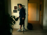 PFC Phil Bauer, enters Captain David Rozelle's home on post after working out at Fort Carson's...