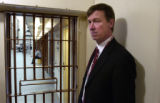 (DENVER, Colo., January 10, 2005)  Mayor John Hickenlooper stands next to the barred door of one...