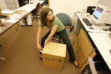 Rina Avalos (cq), an administrative assistant at the Denver Clerk's office, gets a few boxes ready...