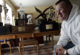 Lt. Col Steve Beck (cq) made the trophies sitting on his dining room table honoring a specific...