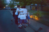 Carolina Valencia, 16 (cq) receives a group hug from her friends in front of a memorial set up for...