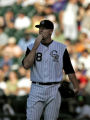 Rockies pitcher Aaron Cook waits for the call by the umps on a controversial  homerun call by...
